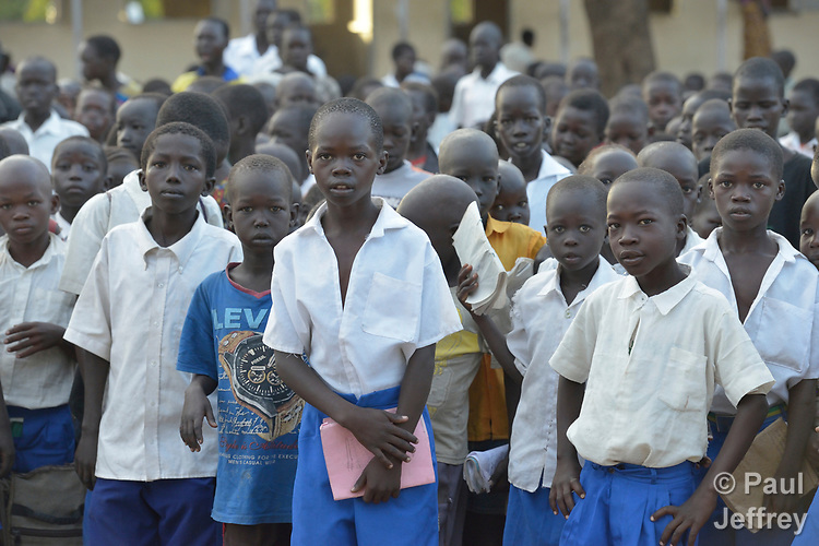 Students in a primary school at Odoubu in the Rhino Refugee Camp in northern Uganda. As of April 2017, the camp held almost 87,000 refugees from South Sudan, and more people were arriving daily. About 1.8 million people have fled South Sudan since civil war broke out there at the end of 2013. About 900,000 have sought refuge in Uganda.