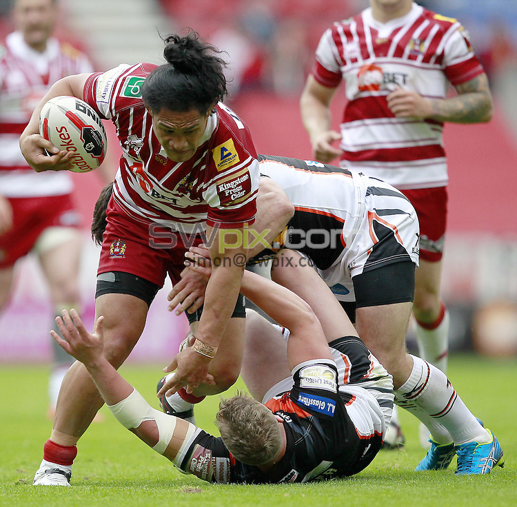 Picture by Chris Mangnall/SWpix.com - 25/06/2016 - Rugby League - 2016 Ladbrokes Challenge Cup Quarter Final - Wigan Warriors v Castleford Tigers - D W Stadium, Wigan, England -<br /> Wigan's  Taulima Tautai tackled by Castleford's Adam Milner and Matt Cook