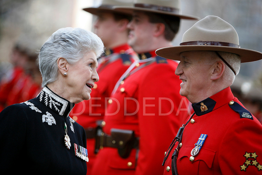 Lieutenant Governor Iona Campagnolo exchanges a few words with a member of the RCMP prior to the Speech from the Throne at the British Columbia  Legislature in Victoria. Photo assignment for Canadian Press (CP) news wire service.
