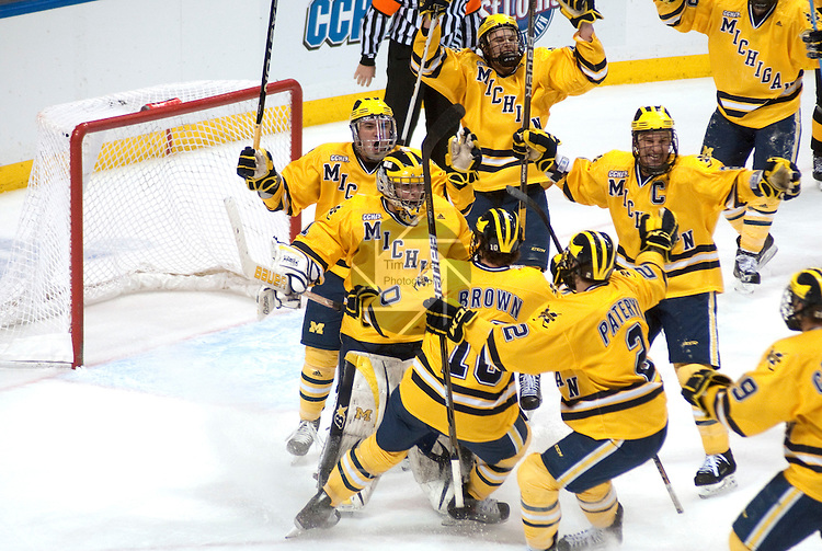 March 26,  2011                      Michigan teammates swarm celebrate after the final buzzer sounded as they defeated Colorado College 2-1 in the championship game of the NCAA Division 1 Men's West Regional Hockey Tournament, on Saturday March 26, 2011 at the Scottrade Center in downtown St. Louis.