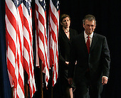 "Chicago, IL - December 11, 2008 -- Former United States Senator  Tom Daschle (Democrat of South Dakota), right, and Dr. Jeanne Lambrew enter the room for a news conference Thursday December 11, 2008, in Chicago, Illinois. In his remarks, Obama said he was ""appalled and disappointed"" by the revelations this week concerning Illinois Governor Rod Blagojevich's alleged attempts to sell Obama's old United States Senate seat..Credit: Frank Polich - Pool via CNP"