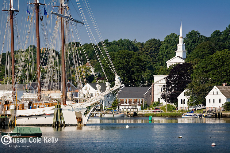 Schooner masts rise above the Mystic River in Mystic, CT, USA