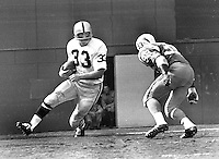 Raider Billy Cannon against San Diego Charger #33<br />