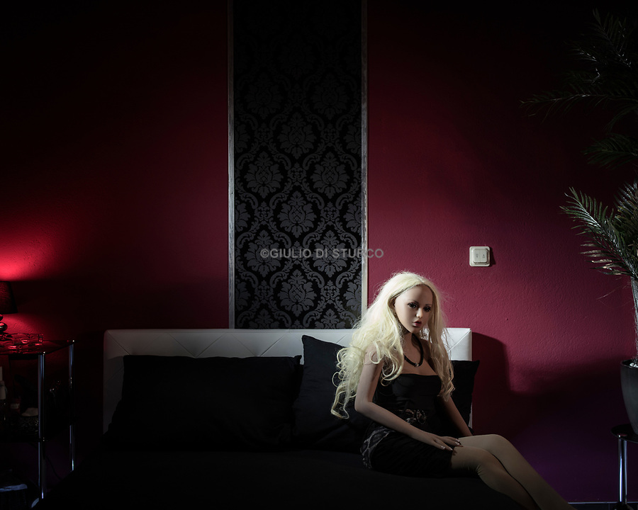 """Laura in the red Room<br /> <br /> <br /> Inside Bordoll, a German sex-doll brothel in Dortmund A brothel in Dortmund offers a dozen sex dolls that users can rent for any service. DW takes a look inside.<br /> Down a dead-end street in a quiet neighborhood south of Dortmund's city center stands Germany's first sex doll brothel.<br /> For €80 ($97) an hour, customers can take one of 12 silicone dolls, including one male doll and a model with both breasts and a penis, into a tidy room to fulfill their sexual desires.<br /> Evelyn Schwarz, 30, is the founder and owner of Bordoll, which is also a brothel and a studio for bondage, dominance, sadism and masochism (BDSM).<br /> A BDSM mistress, Schwarz opened Bordoll last year, after she struggled to find German-speaking women to work in the brothel. In BDSM, she told DW, communication is critical and sex workers who come from abroad and don't speak the language could miss key cues. """"They are nonsentient, they look good, are not sick, they provide whatever service without complaining, and one can make them with the bodily features you like,"""" she said, pointing out some of the positive aspects of sex dolls.<br /> Daily, she said, five to 12 people, mostly men but occasionally women and couples, come by to have sex with the dolls. Schwarz has an assistant who cleans the dolls, redresses them and puts on their makeup. How the dolls are cleaned is a """"house secret,"""" Schwarz said, """"but after every use they are very well cleaned, washed and disinfected."""""""
