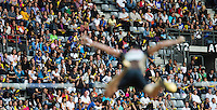 08 JUL 2011 - PARIS, FRA - Spectators watch Renaud Lavillenie clear the bar in the men's pole vault at the Meeting Areva round of the Samsung Diamond League (PHOTO (C) NIGEL FARROW)