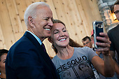 2020 Democratic Presidential candidate, Joe Biden, takes a selfie as he works the rope line after speaking at a campaign event in Burlington, Iowa on Wednesday, August 7, 2019. Biden is kicking off a 4 day tour of Iowa. Credit: Alex Edelman / CNP
