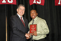 14 January 2007: Bob Bowlsby presents an award to Tyrone McGraw at the annual football banquet at McCaw Hall in Stanford, CA.