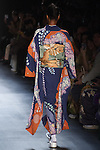 "Model walks runway in an ""Colorful"" silk kimono from the Hiromi Asai Fall Winter 2016 ""Spirit of the Earth"" collection by Hiromi Asai & Kimono Artisan Kyoto, presented at NYFW: The Shows Fall 2016, during New York Fashion Week Fall 2016."