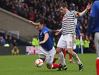 Chris Hegarty fouled by Anthony Quinn in the Queen's Park v Rangers Irn-Bru Scottish League Division Three match played at Hampden Park, Glasgow on 29.12.12.