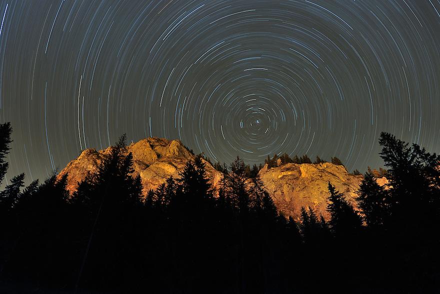 Star tracks on Sky and rock formation, Cheile Bicazului-Hasmas National Park, Carpathian, Transsylvania, Romania,