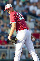 Indiana Hoosiers pitcher Aaron Slegers (31) looks towards first base against the Oregon State Beavers during Game 9 of the 2013 Men's College World Series  on June 19, 2013 at TD Ameritrade Park in Omaha, Nebraska. The Beavers defeated the Hoosiers 1-0, eliminating Indiana from the tournament. (Andrew Woolley/Four Seam Images)