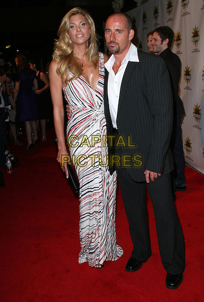 CANDIS CAYNE & DJ MARCO .3rd Annual Hot in Hollywood, held at Avalon, Hollywood, California, .USA, 16 August 2008..full length red white black print maxi long dress married husband wife .CAP/ADM/FS.©Faye Sadou/Admedia/Capital Pictures