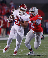 Indiana Hoosiers running back D'Angelo Roberts (20) flees from Ohio State Buckeyes linebacker Ryan Shazier (2) during Saturday's NCAA Division I football game at Ohio Stadium in Columbus on November 23, 2013. Ohio State won the game 42-14. (Barbara J. Perenic/The Columbus Dispatch)