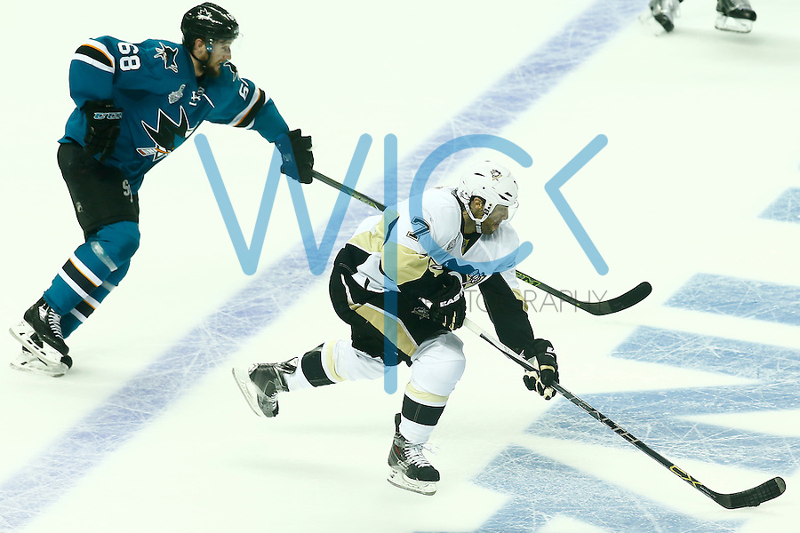 Matt Cullen #7 of the Pittsburgh Penguins carries the puck up the ice past Melker Karlsson #68 of the San Jose Sharks in the first period during game three of the Stanley Cup Final at the SAP Center in San Jose, California on June 4, 2016. (Photo by Jared Wickerham / DKPS)