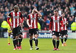 Leon Clarke, Enda Stevens and John Fleck of Sheffield Utd  walk off disappointed during the championship match at the Bramall Lane Stadium, Sheffield. Picture date 14th April 2018. Picture credit should read: Simon Bellis/Sportimage