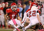 SIOUX FALLS, SD - OCTOBER 16:  Cole DeBerg #7 from Lincoln looks to make a move past Riley Bennett #22 from Brandon Valley in the first half of their game Friday night at Howard Wood Field. (Photo by Dave Eggen/Inertia)