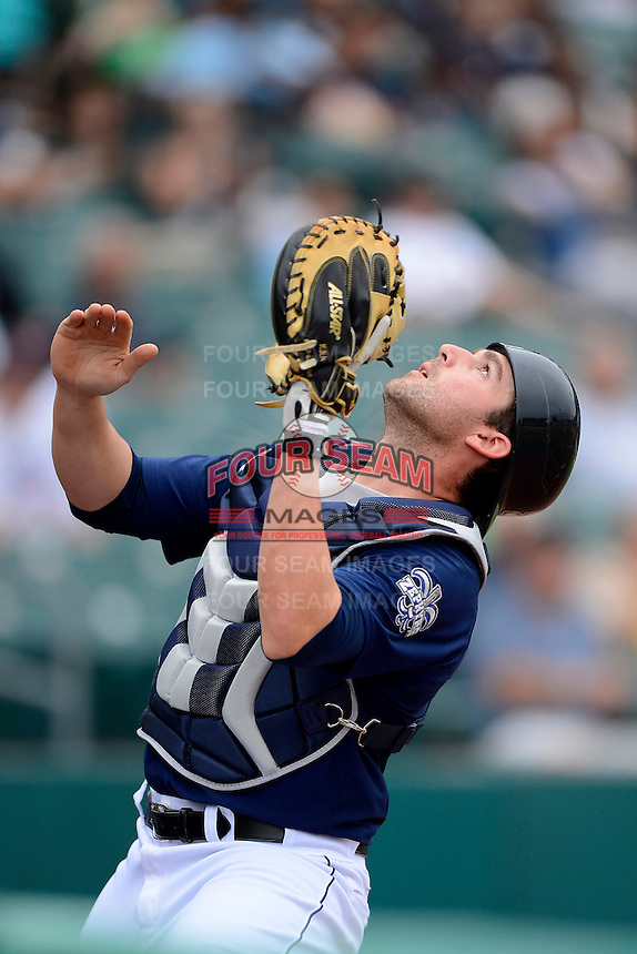 New Orleans Zephyrs catcher Jake Jefferies #8 catches a pop up foul ball during a game against the Round Rock Express on April 15, 2013 at Zephyr Field in New Orleans, Louisiana.  New Orleans defeated Round Rock 3-2.  (Mike Janes/Four Seam Images)