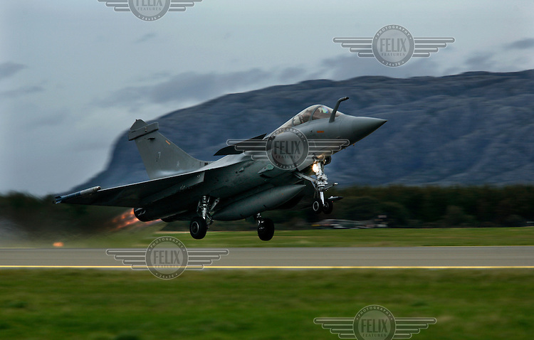 French Navy Dassault Rafale of 12 squadron taking off with afterburner. BOLD AVENGER 2007 (BAR 07), a NATO  air exercise at Ørland Main Air Station, Norway. BAR 07 involved air forces from 13 NATO member nations: Belgium, Canada, the Czech Republic, France, Germany, Greece, Norway, Poland, Romania, Spain, Turkey, the United Kingdom and the United States of America. The exercise was designed to provide training for units in tactical air operations, involving over 100 aircraft, including combat, tanker and airborne early warning aircraft and about 1,450 personnel.