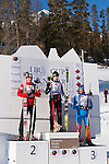 The winners stand on the podium at The International Biathlon Union Cup # 7 Men's 10 KM Sprint held at the Canmore Nordic Center in Canmore Alberta, Canada, on Feb 16, 2012.  In first pace is Canadian Nathan Smith, 2nd is Austrian Friedrich Pinter and Russian Sergey Klyachin in 3rd place.  Photo by Gus Curtis.
