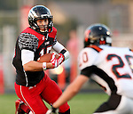 BRANDON, SD - SEPTEMBER 26: Alex Wilde #15 from Brandon Valley looks upfield as the defense of Cole Uithoven #20 from Washington in the first quarter of their game Friday night in Brandon.  (Photo by Dave Eggen/Inertia)
