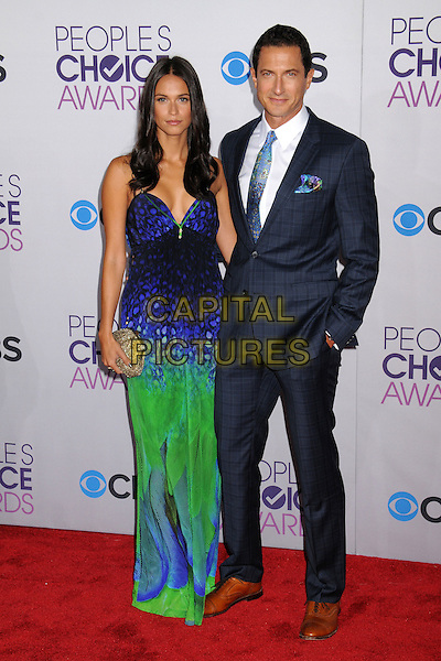 guest & Sasha Roiz.People's Choice Awards 2013 - Arrivals held at Nokia Theatre L.A. Live, Los Angeles, California, USA..January 9th, 2013.full length suit hand in pocket white brown shoes blue tie green check green dress pattern print .CAP/ADM/BP.©Byron Purvis/AdMedia/Capital Pictures.