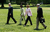 (L-R) United States President George W. Bush walks with Secretary of State Condoleezza Rice, Ann Hadley, and Hadley's husband National Security Adviser Stephen Hadley, as Bush returns to the White House June 8, 2008 in Washington, DC. Bush spent his weekend at Camp David.  <br /> Credit: Alex Wong / Pool via CNP