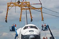 Crew bring a crane into place to hoist the Space Shuttle Enterprise onto the deck of the Intrepid Sea , in New York, June 6, 2012. / VIEW..
