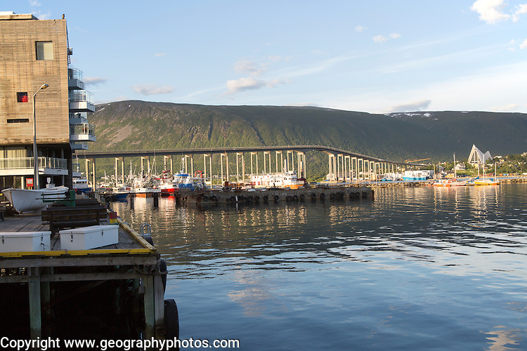 Arctic cathedral church and Tromso Bridge, city of Tromso, Norway,