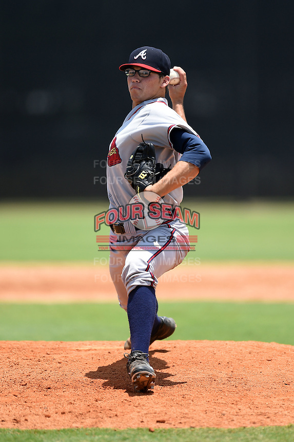 GCL Braves relief pitcher Luis Gamez (64) delivers a pitch during the first game of a doubleheader against the GCL Yankees 1 on July 1, 2014 at the Yankees Minor League Complex in Tampa, Florida.  GCL Yankees 1 defeated the GCL Braves 7-1.  (Mike Janes/Four Seam Images)