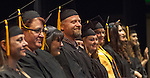 Dave Hardin and fellow students receive recognition from the audience at the Western Nevada College commencement in Fallon, Nev., on Tuesday, May 20, 2014. <br /> Photo by Kim Lamb