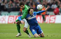 FUSSBALL   1. BUNDESLIGA   SAISON 2011/2012   21. SPIELTAG Werder Bremen - 1899 Hoffenheim                        11.02.2012 Sokratis Papastathopoulos (li, SV Werder Bremen)  gegen Srdjan Lakic (re, Hoffenheim)