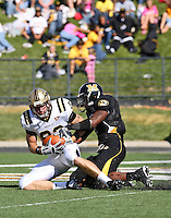Western Michigan Broncos tight end Branden Ledbetter scores on a 27 yard pass play with MU free safety William Moore defending during the fourth quarter at Memorial Stadium in Columbia, Missouri on September 15, 2007. The Tigers won 52-24.