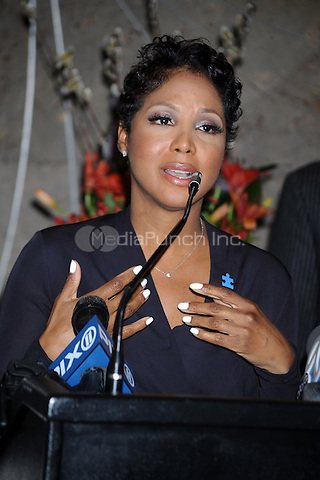 Toni Braxton lights The Empire State Building blue in honor of Autism Speaks the World's largest autism advocacy organization sponsoring autism research. New York City. April 1, 2011 Credit: Dennis Van Tine/MediaPunch