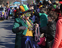 NWA Democrat-Gazette/ANDY SHUPE<br /> Teri Shea (left) laughs with a spectator Saturday, Feb. 6, 2016, as she hands out beads during the 15th Fat Saturday Parade of Fools organized by Fayetteville Mardi Gras in downtown Fayetteville. The 25th annual Fat Tuesday on Dickson Street is planned for 8 p.m. Tuesday beginning at Farrell's Lounge. Visit nwadg.com/photos to see more photographs from the parade.