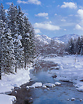 Okanogan County, WA<br /> The Methow River and its tree lined banks covered with a fresh snowfall