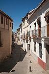 Narrow streets of Moorish houses in the Albaicin district, San Juan de Los Reyes street, Granada, Spain