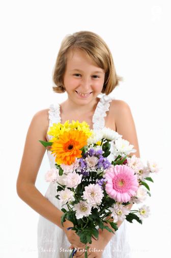 Smiling Girl (10)  holding bouquet of flowers (Licence this image exclusively with Getty: http://www.gettyimages.com/detail/103301308 )