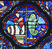 A man sits astride a barrel of wine topping it up from a keg, and to the right, a fantastic scorpion creature with 4 legs and a dog's head on its tail, section of October and Scorpio from the Zodiac and the labours of the months stained glass window, 1217, in the ambulatory of Chartres Cathedral, Eure-et-Loir, France. This calendar window contains scenes showing the zodiacal symbol with its corresponding monthly activity. Chartres cathedral was built 1194-1250 and is a fine example of Gothic architecture. Most of its windows date from 1205-40 although a few earlier 12th century examples are also intact. It was declared a UNESCO World Heritage Site in 1979. Picture by Manuel Cohen