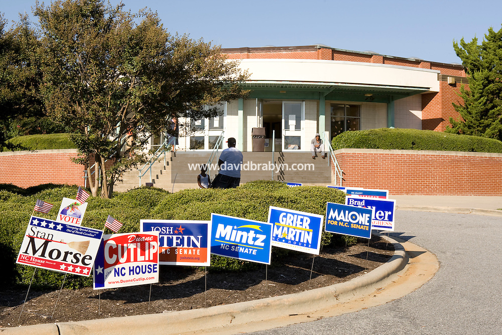 Campaign yard signs stand in front of the Chavis community center voting site in Raleigh, NC, United States, 16 October 2008, the first day of early voting in the state for the 2008 US presidential election.