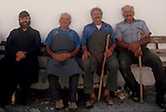 Crete, Greece, Town of Vizari,  Fourfouras area, happy local farmers, priest, in the shade, raki drinkers all,.
