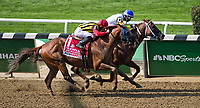 ELMONT, NY - JUNE 09: Bee Jersey  #10, ridden by Ricardo Santana, wins the Runhappy Metropolitan Handicap on Belmont Stakes Day at Belmont Park on June 9, 2018 in Elmont, New York. (Photo by John Voorhees/Eclipse Sportswire/Getty Images)