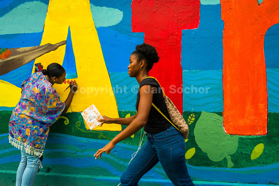 "Afro-Colombian female students paint a society and environment-related mural on a school wall in Quibdó, Colombia, 5 October 2019. Supervised by a Bogotan street artist named Guache, a group of young activists from Chocó department created a large artwork called ""Somos Atrato"" (""We are [the river] Atrato"") celebrating the Afro-Colombian heritage and accenting the inherent link between the communities and the river Atrato in the Pacific region of Colombia."