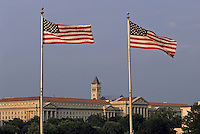 USA, two American flags with Old Post Office building viewed from Washington Monument