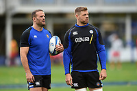 Jamie Roberts and Dave Attwood of Bath Rugby look on during the pre-match warm-up. Heineken Champions Cup match, between Bath Rugby and Stade Toulousain on October 13, 2018 at the Recreation Ground in Bath, England. Photo by: Patrick Khachfe / Onside Images