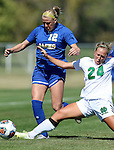 BROOKINGS, SD - SEPTEMBER 20: Dani Patterson #12 from South Dakota State has the ball knocked from her by Michelle Stingle #24 from North Dakota in the first half of their match Sunday afternoon in Brookings. (Photo by Dave Eggen/Inertia)
