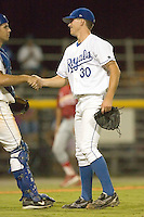 Burlington relief pitcher Ted Gjeldum (30) shakes hands with catcher Nick Doscher (8) after nailing down the Royals 9-4 win over the Johnson City Cardinals at Burlington Athletic Park in Burlington, NC, Saturday, August 25, 2007.