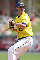 March 21, 2010:  Pitcher Travis Smith (29) of the Michigan Wolverines delivers a pitch during a game at Tradition Field in St. Lucie, FL.  Photo By Mike Janes/Four Seam Images