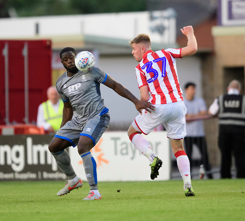 Lincoln City's John Akinde vies for possession with Stoke City's Nathan Collins<br /> <br /> Photographer Chris Vaughan/CameraSport<br /> <br /> Football Pre-Season Friendly - Lincoln City v Stoke City - Wednesday July 24th 2019 - Sincil Bank - Lincoln<br /> <br /> World Copyright © 2019 CameraSport. All rights reserved. 43 Linden Ave. Countesthorpe. Leicester. England. LE8 5PG - Tel: +44 (0) 116 277 4147 - admin@camerasport.com - www.camerasport.com
