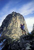Climber standing on ridge in front of South Early Winter's Spire, North Cascade Mountains, Washington.