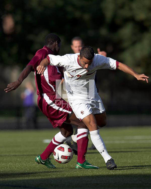 Boston College forward/midfielder Amit Aburmad (7) attempts to dribble through Harvard defense. Boston College defeated Harvard University, 2-0, at Newton Campus Field, October 11, 2011.
